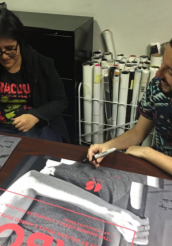 Co-Directors Juliana Rojas and Marco Dutra signing the 10 limited edition posters for HARD LABOR.